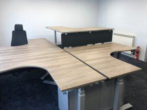 working island formed by 4 EDF03T triple motor sti-stand desks