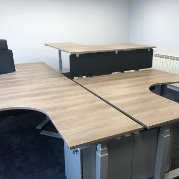 working island formed by 4 EDF03T triple motor sti-stand desks